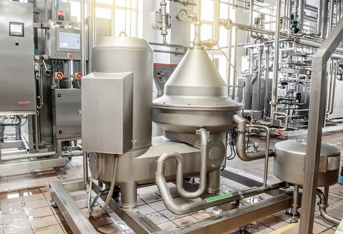 Installation for pasteurization of milk at a dairy plant. Brilliant stainless steel pipes. Abstract industrial background