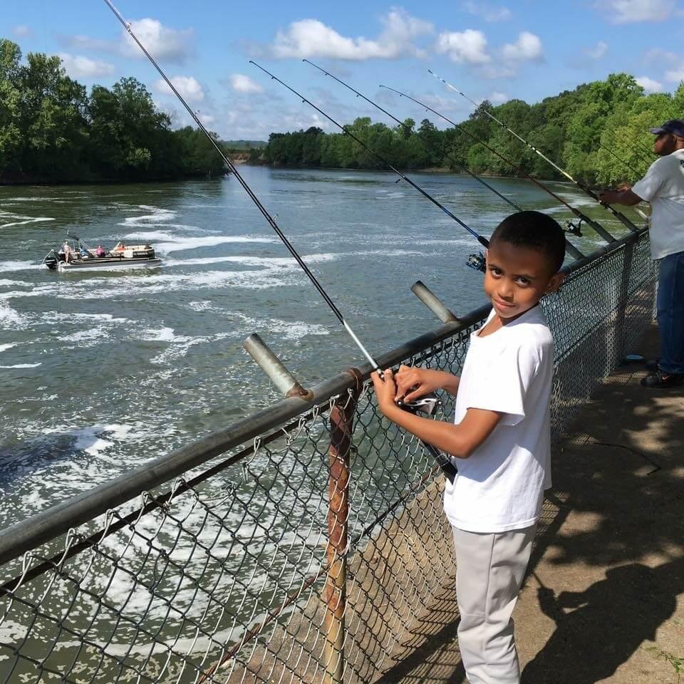 Fishing on Lock wall kid